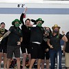 Northridge girls swimmers and coaches cheer on their team during the sectional finals Saturday in Elkhart.