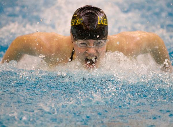 SAM HOUSEHOLDER   THE GOSHEN NEWS<br /> Northridge freshman Melissa Bailey swims the 100 yard butterfly during the NLC swimming preliminaries Thursday at Northrdige High School.