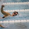 SAM HOUSEHOLDER | THE GOSHEN NEWS<br /> Northridge freshman Lauren Miller swims the 100 yard freestyle heat during the conference preliminaries Thursday at Northridge High School.
