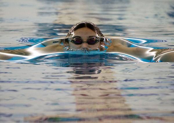 SAM HOUSEHOLDER | THE GOSHEN NEWS<br /> Concord swimmer Stephen Krecsmar swims the 100 yard breaststroke Thursday during the meet against Mishawaka.