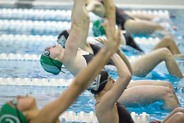 SAM HOUSEHOLDER   THE GOSHEN NEWS<br /> Concord swimmer Maddisen Lantz dives into the pool during the 100 yard backstroke during the meet against Mishawaka Thursday.