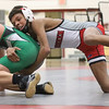 JAY YOUNG   THE GOSHEN NEWS<br /> Goshen freshman Rasheek Bonds, right, spends behind Concord freshman Logan Lawson as the two battle in the 113 pound class during their wrestling meet Thursday evening at GHS.