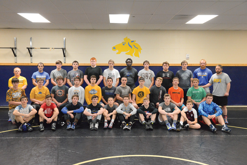 Justin Sheely | The Sheridan Press<br /> The Sheridan High School wrestling team, back row, from left, coach Kasey Garnhart, head coach Tyson Shatto, Sam Smart, Camden McArthur, Justin Vela, Brenden Clem, Wesley Ndago, Tristan Scheeles, Joel Sayer, Leif Norskog and coach Mark Lane. Middle row, from left, Mason Lydic, Vera Torkelson, Mikel Dobson, Jake Thomas, Garrett Coor, Drake deCastro, Chance Watt, Kel Tritschler, Chance Quarterman, Hayden Crow, Thomas Serenson and coach Kyle Ewing. Front row, from left, Branton Williams, Zach Dilloway, Quinn Heyneman, Trevon Covolo, Nicolas Clemens, Matthew Legler, Reese Osborne, Steen Avery, Drake Fisgus and Ethan Johnson.