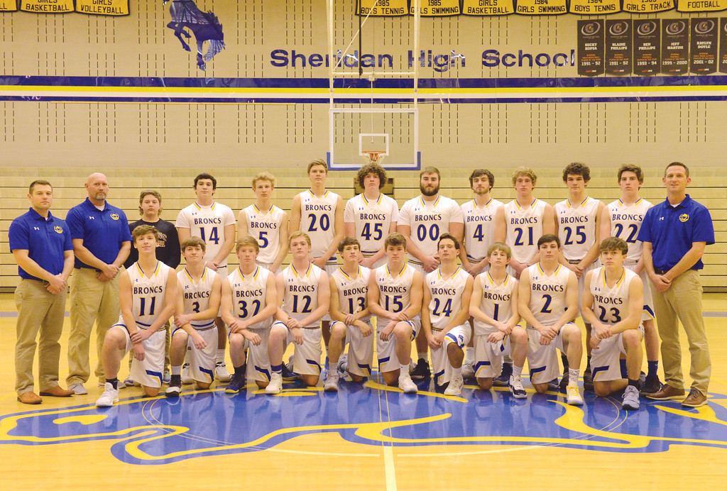 Justin Sheely | The Sheridan Press<br /> The Sheridan High School boys basketball team, back row, from left: coach Tim Cooper, coach Mark Elliott, manager Ben Novotny, Ryan Sessions, Abraham Ross, Gus Wright, Samuel Lecholat, Blayne Baker, Aaron Woodward, Parker Christensen, Josh Ahrens, Dalton Gregory and head coach Jeff Martini. Front row, from left: Than Rickett, Kirby Coe-Kirkham, Brock Bomar, Jacob Boint, Noah Erickson, Tristan Bower, Kyle Custis, Carter Wells, Aaron Sessions and Elliot Boley.