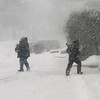 Winter storm features in Billerica. Josue Ramos of Lynn, right, who works for O'Connor Hardware, keep the front clear of snow.  (SUN/Julia Malakie)