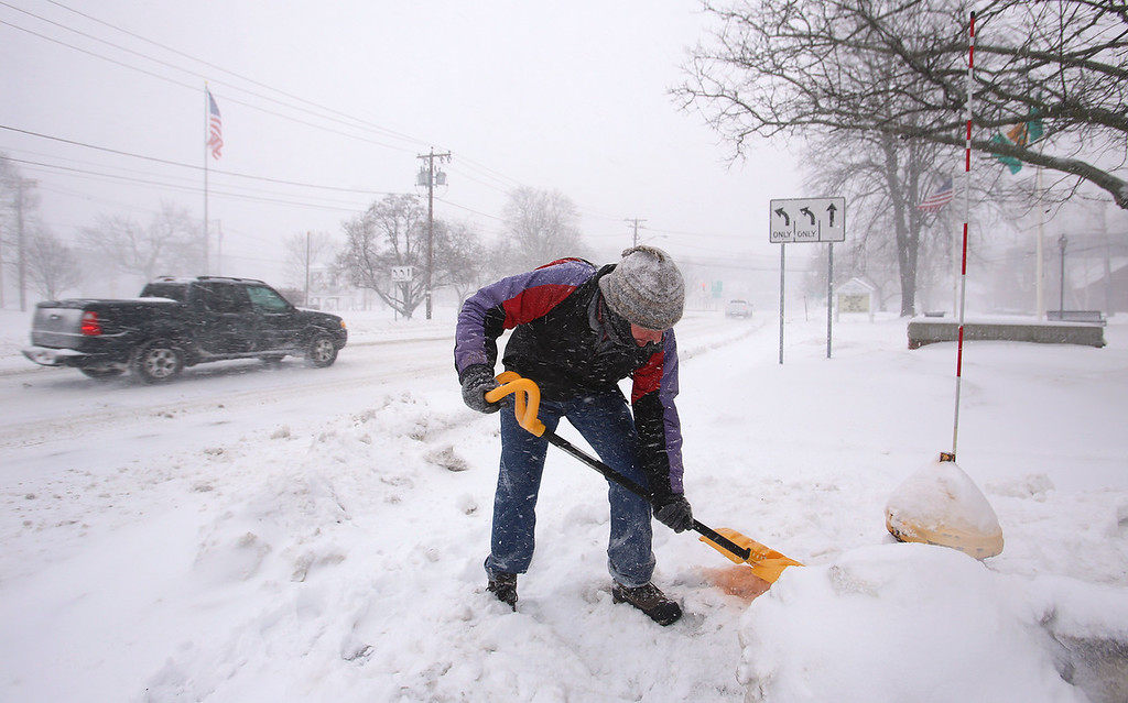 . Winter storm features in Billerica. John Marshall of Billerica clears snow from the hydrant in front of the Billerica Public Library. He said he hears on the radio about the need to shovel hydrants, and does the one nearer his house. This one was extra. (SUN/Julia Malakie)