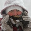 Leslie Horton of Dunstable covered in snow after snowblowing her driveway. SUN/DAVID H. BROW