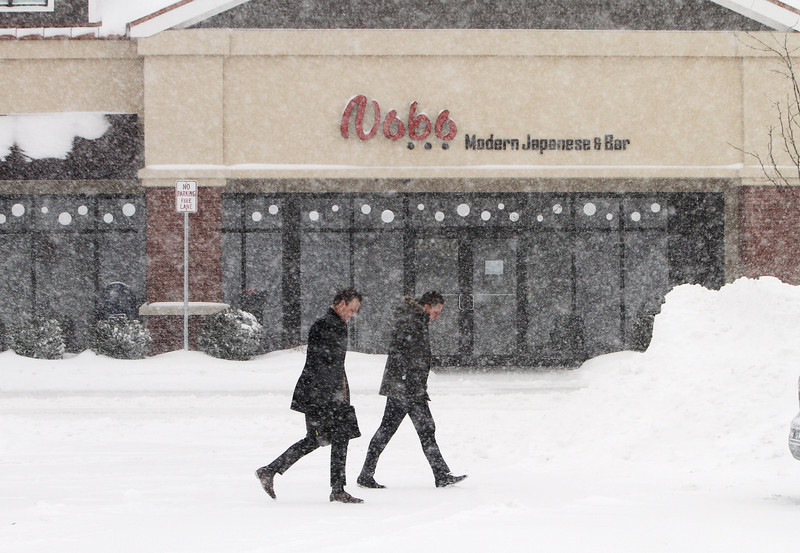 Winter storm features in Chelmsford. Customers head for car at Chelmsford Town Center. (SUN/Julia Malakie)