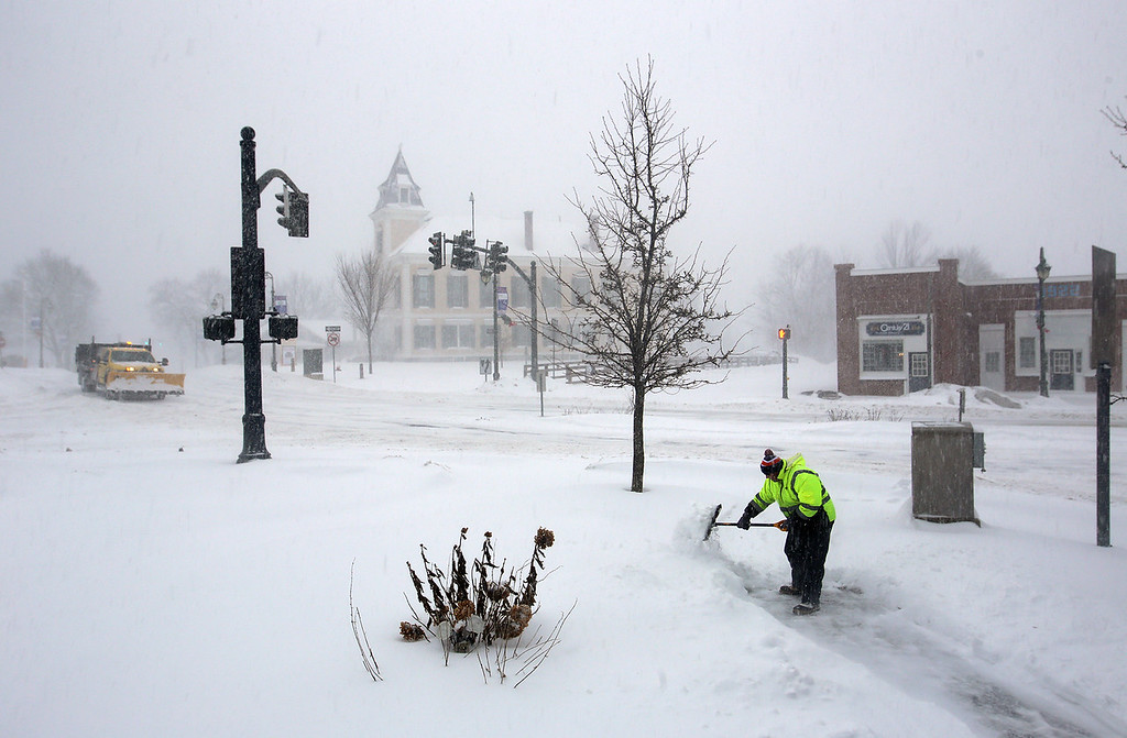 . Winter storm features in Chelmsford Center. John Doherty of Jaffrey, N.H., who works for Merrimack Property Management, shovels the walk and steps at Central House apartments in Chelmsford Center.(SUN/Julia Malakie)