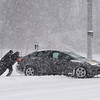 Winter storm features in Chelmsford. Man from this car, and from the next car coming off the exit from Rt 3 Southbound to Rt 110 in Chelmsford, push the car out of the snow onto Rt 110. (SUN/Julia Malakie)