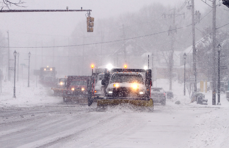 Winter storm features in Billerica, Chelmsford and Lowell. Plows on Rt 3A in Billerica Center. (SUN/Julia Malakie)