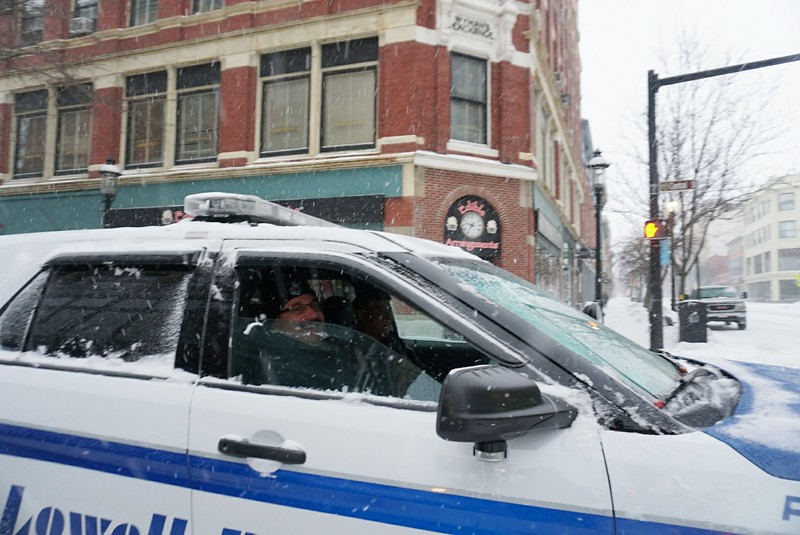 Lowell police officers at Central and Merrimack Streets. (SUN PHOTO/ Chris Tierney)