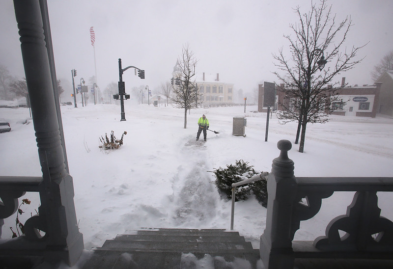 Winter storm features in Chelmsford Center. John Doherty of Jaffrey, N.H., who works for Merrimack Property Management, shovels the walk and steps at Central House apartments in Chelmsford Center.(SUN/Julia Malakie)