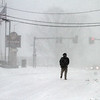 Winter storm features in Lowell. Nara Chan of Lowell walks home on Rt 110 from Kohl's. He'd just gone to buy his jacket because he had a coupon, and got tired of waiting for the bus home. (SUN/Julia Malakie)