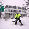 Winter storm features in Chelmsford Center. John Doherty of Jaffrey, N.H., who works for Merrimack Property Management, shovels the walk and steps at Central House apartments in Chelmsford Center. (SUN/Julia Malakie)