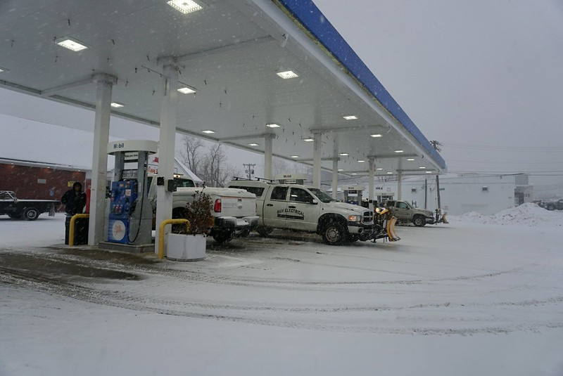 Plow trucks filling up at Mobil On Lakeview in Dracut. (SUN PHOTO/ Chris Tierney)