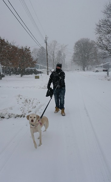 Jason Pasquariello and dog Mila on turgeon Ave In Dracut. (SUN PHOTO/ Chris Tierney)