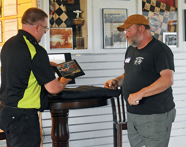 Ken Minott (left) presents Kenny Wright with a photo of Wright holding a trophy. Wright was inducted into the Wiscasset Speedway Hall of Fame on Saturday, July 25. (Alexander Violo photo)