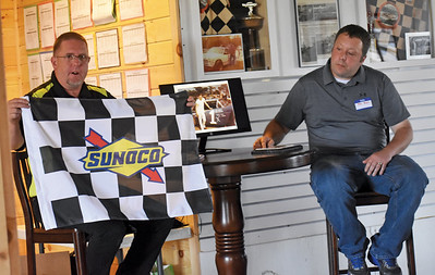 Ken Minott (left) holds up a checkered flag that will be embroidered with the late Mike Moody's name. Mike Moody's son, also named Mike Moody (right), was on hand for his father's induction into the Wiscasset Speedway Hall of Fame. (Alexander Violo photo)