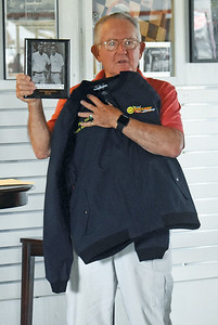 Bill Cost, a former announcer and promoter at Wiscasset Speedway, holds a jacket and a photo of himself during his time working at the track. Cost was inducted into the Wiscasset Speedway Hall of Fame on Saturday, July 25. (Alexander Violo photo)