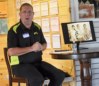 Ken Minott, announcer and promoter at Wiscasset Speedway, announces the induction of six new members of the track's hall of fame during a luncheon at the speedway, Saturday, July 25. (Alexander Violo photo)