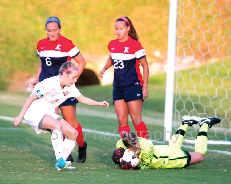 Star Photo/Larry N. Souders<br /> King College goalie Olivia Drake (1) prevents a rebound shot on goal by Milligan's Dharma Fawbush (20) with this save early in first half.