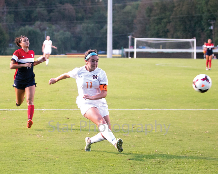 Star Photo/Larry N. Souders<br /> Milligan's Brittany Davis (11) takes a shot on goal from inside the goalie box late in the first half.