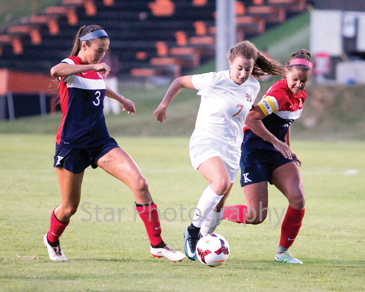 Star Photo/Larry N. Souders<br /> Milligan's Poppy Smith dribbles between two Lady Tornado's defenders as she drives toward the goal.