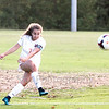 Star Photo/Larry N. Souders<br /> Milligan's Poppy Smith (7) fires a corner kick towards the goal midway through the first half.