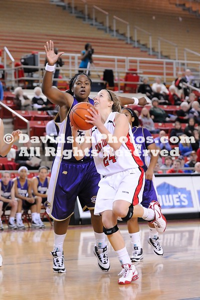 DAVIDSON, NC - Ashley Lax (24) drives to th hoop for 2 of her team high 20 points as the Davidson Wildcats defeat Western Carolina 84-66 in SoCon action.