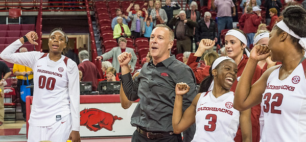 Arkansas head coach Jimmy Dykes and players call the hogs after a basketball game between Arkansas and Texas A&M on January 7, 2016.    (Alan Jamison, Nate Allen Sports Service)