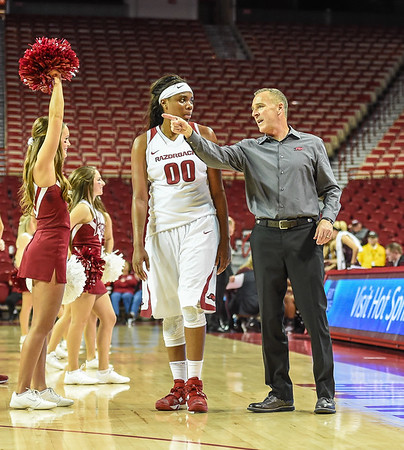 Arkansas head coach Jimmy Dykes instructs Arkansas Lady Razorbacks forward Jessica Jackson (00) during a timeout in a basketball game between Arkansas and Missouri State on December 2, 2015.    (Alan Jamison, Nate Allen Sports Service)