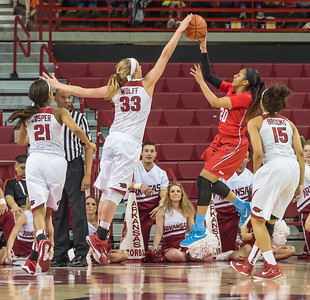 Arkansas Lady Razorbacks forward Melissa Wolff (33) blocks a shot by Mississippi Lady Rebels guard Madinah Muhammad (20) during a basketball game between Arkansas and Ole Miss on 2-28-16.   (Alan Jamison, Nate Allen Sports Service)