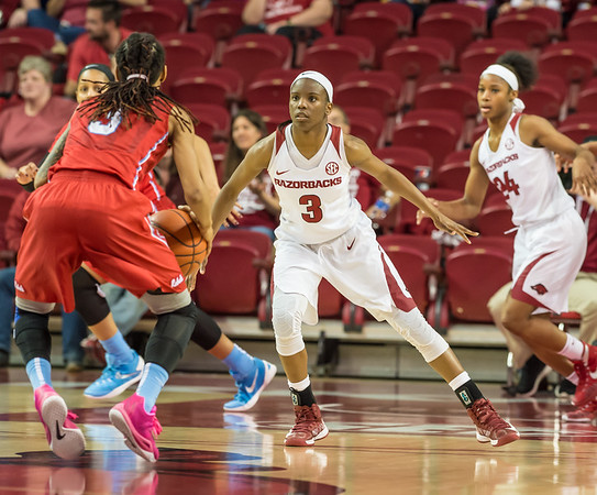 Arkansas Lady Razorbacks guard Malica Monk (3) defends against her counterpart Mississippi Lady Rebels guard A'Queen Hayes (3) during a basketball game between Arkansas and Ole Miss on 2-28-16.   (Alan Jamison, Nate Allen Sports Service)