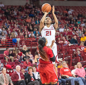 Arkansas Lady Razorbacks guard Devin Cosper (21) shoots a jump shot during a basketball game between Arkansas and Ole Miss on 2-28-16.   (Alan Jamison, Nate Allen Sports Service)