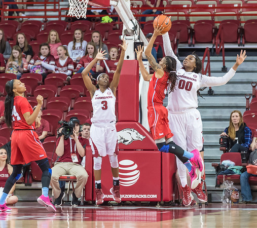 Arkansas Lady Razorbacks forward Jessica Jackson (00) blocks a shot by Mississippi Lady Rebels guard A'Queen Hayes (3) during a basketball game between Arkansas and Ole Miss on 2-28-16.   (Alan Jamison, Nate Allen Sports Service)