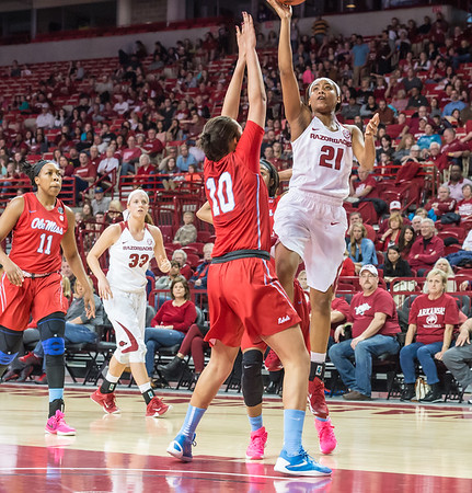 Arkansas Lady Razorbacks guard Devin Cosper (21) shoots during a basketball game between Arkansas and Ole Miss on 2-28-16.   (Alan Jamison, Nate Allen Sports Service)