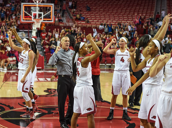 Heady Coach Jimmy Dykes and team call the hogs after winning a basketball game between Arkansas and Southeastern Louisiana on November 13, 2015.    (Alan Jamison, Nate Allen Sports Service)