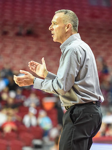 Arkansas Head Coach Jimmy Dykes applauds during a basketball game between Arkansas and Southeastern Louisiana on November 13, 2015.    (Alan Jamison, Nate Allen Sports Service)