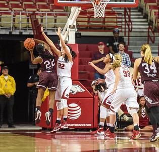 Arkansas Lady Razorbacks guard/forward Bailey Zimmerman (22) defends against Missouri State Bears guard Tyonna Snow (22) during a basketball game between Arkansas and Missouri State on December 2, 2015.    (Alan Jamison, Nate Allen Sports Service)