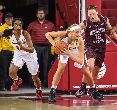 Arkansas Lady Razorbacks guard/forward Keiryn Swenson (4)  clears a rebound during a basketball game between Arkansas and Missouri State on December 2, 2015.    (Alan Jamison, Nate Allen Sports Service)