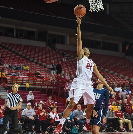 Arkansas Lady Razorbacks guard Devin Cosper (21) with a layup during a basketball game between Arkansas and Oral Roberts on December 10, 2015.    (Alan Jamison, Nate Allen Sports Service)