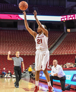 Arkansas Lady Razorbacks guard Devin Cosper (21) shoots a three pointer during a basketball game between Arkansas and Oral Roberts on December 10, 2015.    (Alan Jamison, Nate Allen Sports Service)