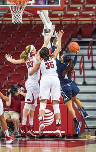 Arkansas Lady Razorbacks center Alecia Cooley (35) and Arkansas Lady Razorbacks forward Melissa Wolff (33) guard Oral Roberts Golden Eagles guard Kaylan Mayberry (1) during a basketball game between Arkansas and Oral Roberts on December 10, 2015.    (Alan Jamison, Nate Allen Sports Service)