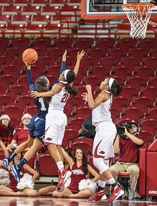 Arkansas Lady Razorbacks guard Devin Cosper (21) and Arkansas Lady Razorbacks center Alecia Cooley (35) guard Oral Roberts Golden Eagles guard Kaylan Mayberry (1) during a basketball game between Arkansas and Oral Roberts on December 10, 2015.    (Alan Jamison, Nate Allen Sports Service)