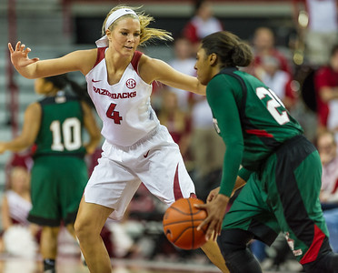 Arkansas Lady Razorbacks guard/forward Keiryn Swenson (4) defends against Mississippi Valley State Devilettes guard Christina Reed (25) during a basketball game between Arkansas and Mississippi Valley State on December 28, 2015.    (Alan Jamison, Nate Allen Sports Service)