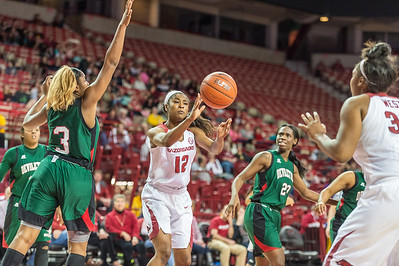 Arkansas Lady Razorbacks guard Briunna Freeman (12) with an assist to Arkansas Lady Razorbacks forward Khadijah West (32) during a basketball game between Arkansas and Mississippi Valley State on December 28, 2015.    (Alan Jamison, Nate Allen Sports Service)