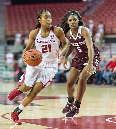 Arkansas Lady Razorbacks guard Devin Cosper (21) drives to the basket during a basketball game between Arkansas and Texas A&M on January 7, 2016.    (Alan Jamison, Nate Allen Sports Service)