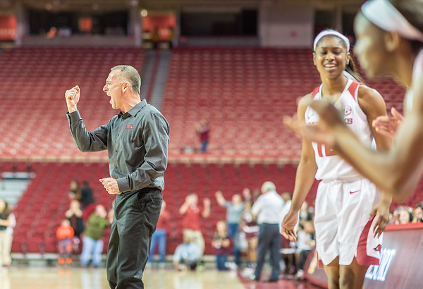 Arkansas Lady Razorbacks head coach Jimmy Dykes celebrates a play during a basketball game between Arkansas and Texas A&M on January 7, 2016.    (Alan Jamison, Nate Allen Sports Service)