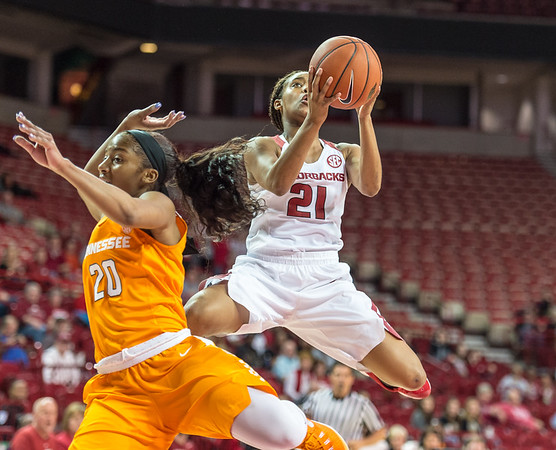 Arkansas Lady Razorbacks guard Devin Cosper (21) shoots over Tennessee Lady Volunteers guard Te'a Cooper (20) during a basketball game between Arkansas and Tennessee on January 14, 2016.    (Alan Jamison, Nate Allen Sports Service)